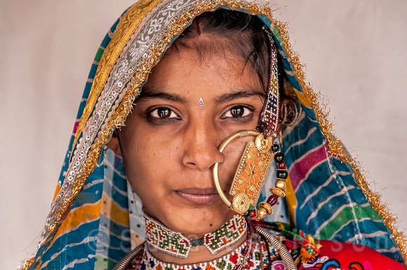 Portrait of a young tribal woman with nose ring.