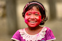 Portrait of a happy little tribal girl celebrating Holi