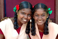 Portrait of two beautiful teenage girls from St. Joseph's orphanage who attend local highschool